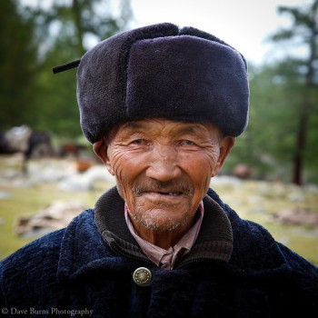 A Kazakh man poses in his heavy coat and heat in western Mongolia