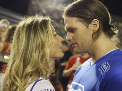 Brazilian supermodel Gisele Bundchen, left, talks with her husband, U.S. football player Tom Brady, during a carnival parade at the Sambadrome in Rio de Janeiro, Brazil, early Monday March 7, 2011. (AP Photo/Rodrigo Abd) Original Filename: AP99123104356.jpgvia Flatbed Web